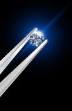 Diamond held by tweezers. Image include hand-draw  clipping path Royalty Free Stock Photography
