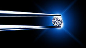 Diamond held by tweezers. Close up Stock Photos