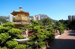 Golden Pagoda in Nan Lian Garden, Kowloon. DIAMOND HILL, HONG KONG - DEC 18, 2013 - Nan Lian Garden is one of Hong Kong`s largest religious sites and a popular stock photo