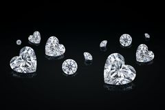 Diamond isolated on black background. Luxury colorless transparent sparkling gemstone diamond heart shape cut