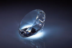 Diamond jewel on dark blue Stock Photography