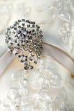 Diamond jewelry on vintage wedding dress Royalty Free Stock Photo