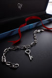 Diamond key-shaped bracelet stock photography