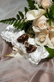 Diamond Laced Bridal Garter. Bridal garder with bow and diamonds with floral background Stock Photo