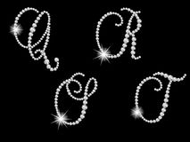 Diamond letters. Luxury diamond letters against black background Royalty Free Stock Image