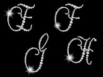 Diamond letters. Luxury diamond letters against black background Stock Images