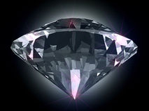 Diamond in the light. Beam on black background Royalty Free Stock Photography