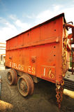 Diamond mine Explosives Cart #16. Close up of well used, red cart with rusty wheels. Used to transport explosives from the safety zone to the blasting site Royalty Free Stock Images