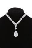 Diamond necklace on black mannequin isolated on white Stock Photo