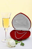 Diamond necklace with champagne and white rose. Royalty Free Stock Images