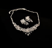 Diamond necklace and earrings Royalty Free Stock Photos