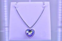Diamond necklace with large heart-shaped diamond. Purple Heart Diamond Necklace beautiful and expensive luxury Royalty Free Stock Image