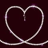 Diamond Necklace Lying In Form Of Heart Stock Photography