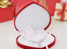 Diamond necklace present. Diamond necklace in a heart shaped box Royalty Free Stock Images