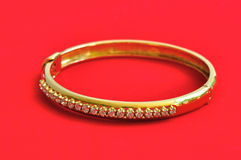 Diamond On The Golden Bracelet Stock Images