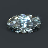 Diamond oval brilliant cut isolated. Beautiful big oval shaped diamond. Brilliant cutting with sparkling dazzling glare Stock Photo