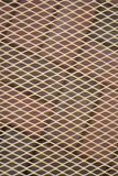 Diamond pattern layered over a brick patio background Stock Photography
