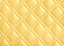 Diamond pattern texture in gold color. Detail of  diamond pattern texture in gold color Stock Images