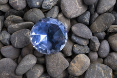 Diamond among pebbles Stock Photography