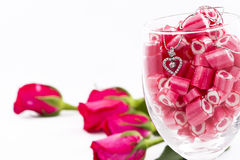 Diamond Pendant And Candy With Rose Stock Photo