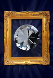 Diamond in picture frame. A large, sparkling cut diamond in an old, ornate picture frame Royalty Free Stock Photos