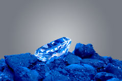 Diamond in a pile of coal Royalty Free Stock Image