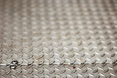 Diamond Plate. Industrial diamond plate floor shot with shallow depth of field Stock Images