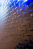 Diamond plate with blue lights portrait Stock Images