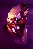 Diamond on purple. Shiny diamond on purple light Stock Images