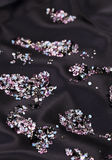 Diamond (purple jewel) stones over black silk Royalty Free Stock Photo