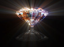Diamond with reflection and shine. Over a black background Royalty Free Stock Photos