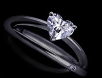 Diamond Ring. White gold ring with a large diamond isolated on a black background Royalty Free Stock Images