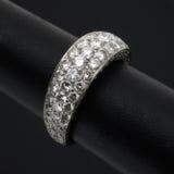 Diamond ring. Ornate diamond encrusted ring on black Stock Image