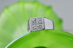 Diamond ring. Placed on top of a bottle of green diamond ring Stock Images