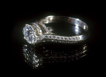 Diamond ring. White gold diamond ring isolated on black background Stock Photo