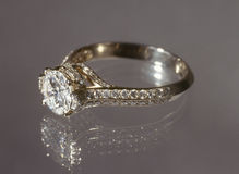 Diamond ring. Beautiful gold diamond ring on gray background Stock Photo