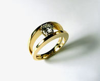 Diamond ring. Diamond engagement ring with a round brilliant cut diamond set in eighteen carat yellow gold royalty free stock images