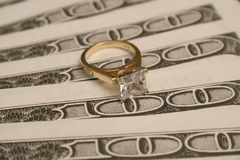 Diamond ring on BIG money background. Shot of a diamond ring & money background Royalty Free Stock Images
