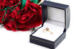 Diamond ring and bouquet paper red roses Stock Photography