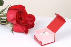 Diamond ring in box and red rose Stock Photos