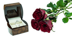 Diamond ring in box with red rose on white background Royalty Free Stock Photography
