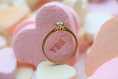 Diamond ring and candy hearts Royalty Free Stock Images