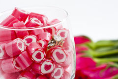 Diamond Ring and Candy in wine glass. Valentine Series, Diamond Ring and Candy in wine glass on white background stock images
