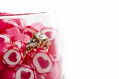 Diamond Ring and Candy in wine glass Stock Images