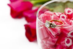 Diamond Ring and Candy in wine glass Royalty Free Stock Images