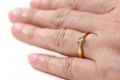 Diamond ring E color of HRD in ring finger Royalty Free Stock Image