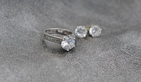 Diamond ring and earrings Stock Photography