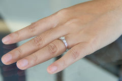 Diamond ring. On female finger Royalty Free Stock Photos