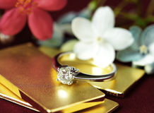 Diamond Ring on Gold Bar Flower Background Royalty Free Stock Image