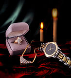 Diamond ring, gold watch, and necklace royalty free stock images